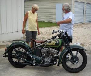 1 - Builder  Dennis Craig briefs Cannonball Rider Dottie Mattern on the idiosyncracies of her rebuilt 1936 Indian Scout