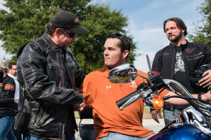 "Bill Davidson, great-grandson of Harley-Davidson co-founder William A. Davidson, congratulates U.S. Air Force veteran Dorsey ""Barney"" Fyffe after delivering a 2015 Harley-Davidson motorcycle while Jason Cross, a U.S. Marine Corps veteran and retail supply planner at Harley-Davidson looks on. The surprise delivery jumpstarted a new partnership between Harley-Davidson and Wounded Warrior Project to help improve the lives of service men and women living with post-traumatic stress disorder (PTSD)."