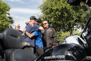 U.S. Marine veteran Raymond Andalio and U.S. Army veteran Brian Torres embrace after learning they both would receive brand-new 2015 Harley-Davidson motorcycles. The surprise delivery jumpstarted a new partnership between Harley-Davidson and Wounded Warrior Project to help improve the lives of service men and women living with post-traumatic stress disorder (PTSD).