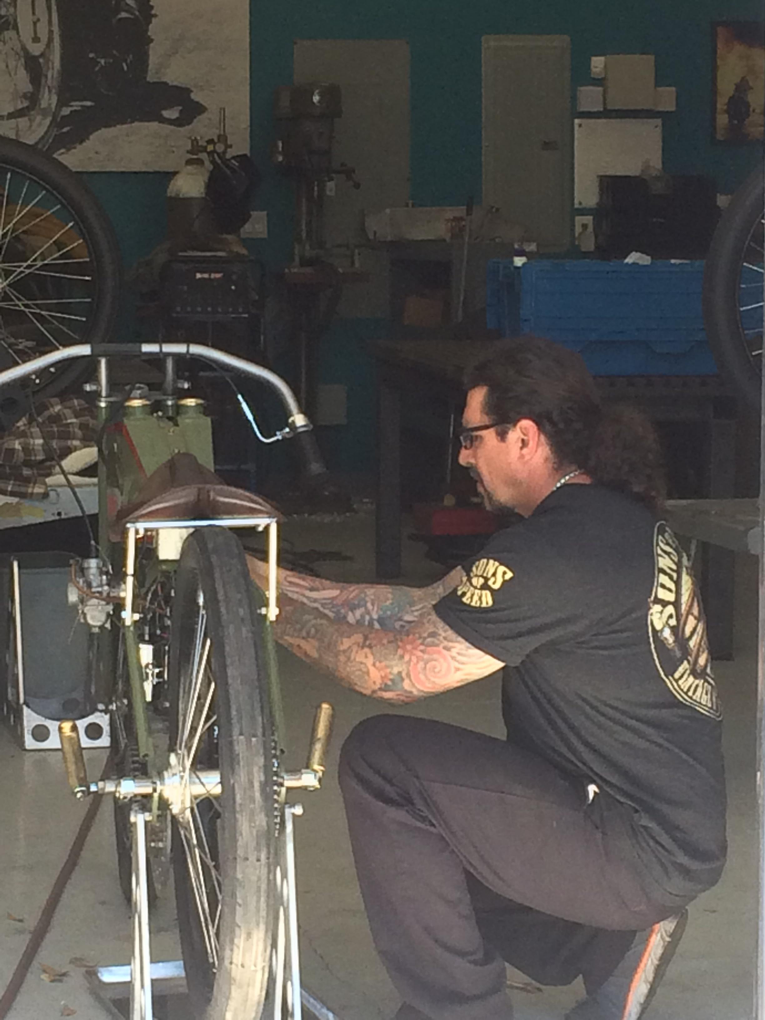 Billy works tirelessly to get motorcycles ready for race day