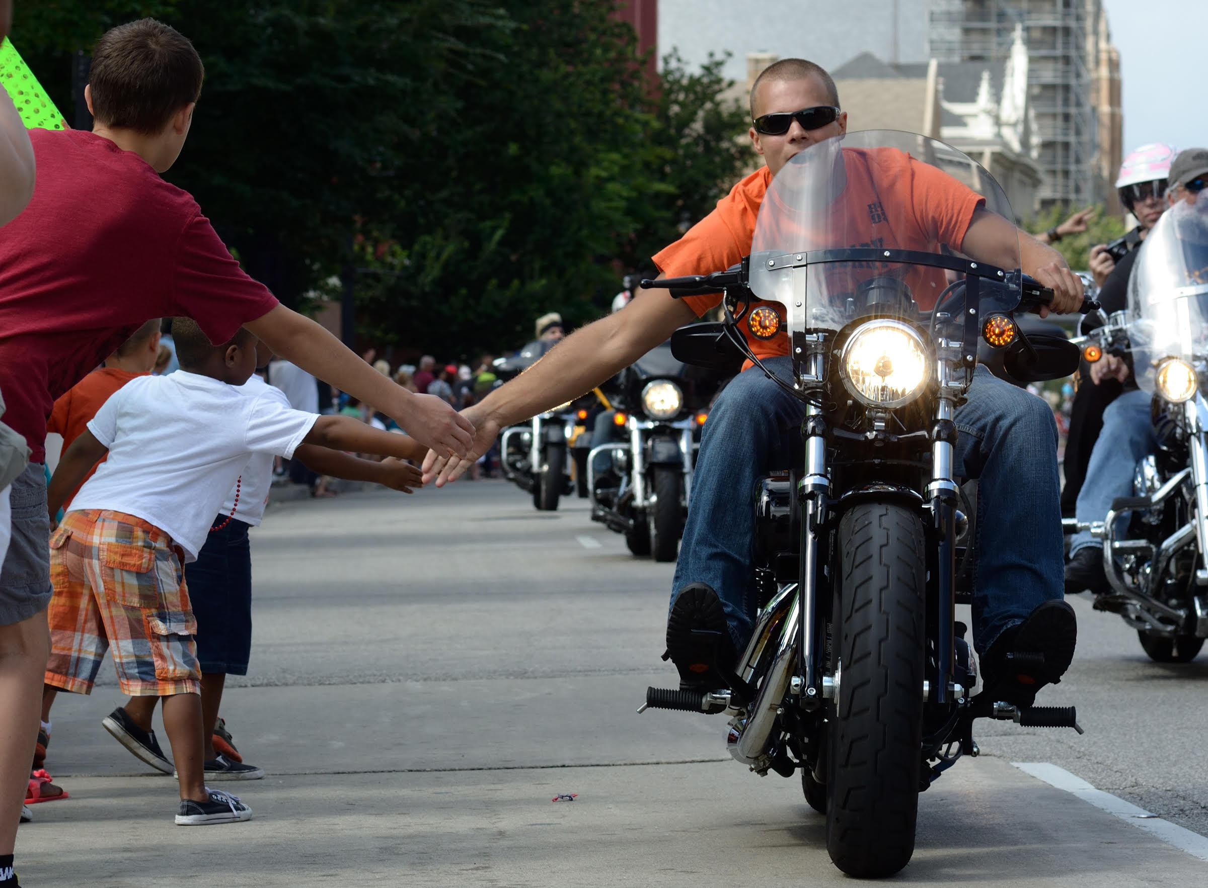 High Fives at the 110th Harley-Davidson parade on Wisconsin Road.
