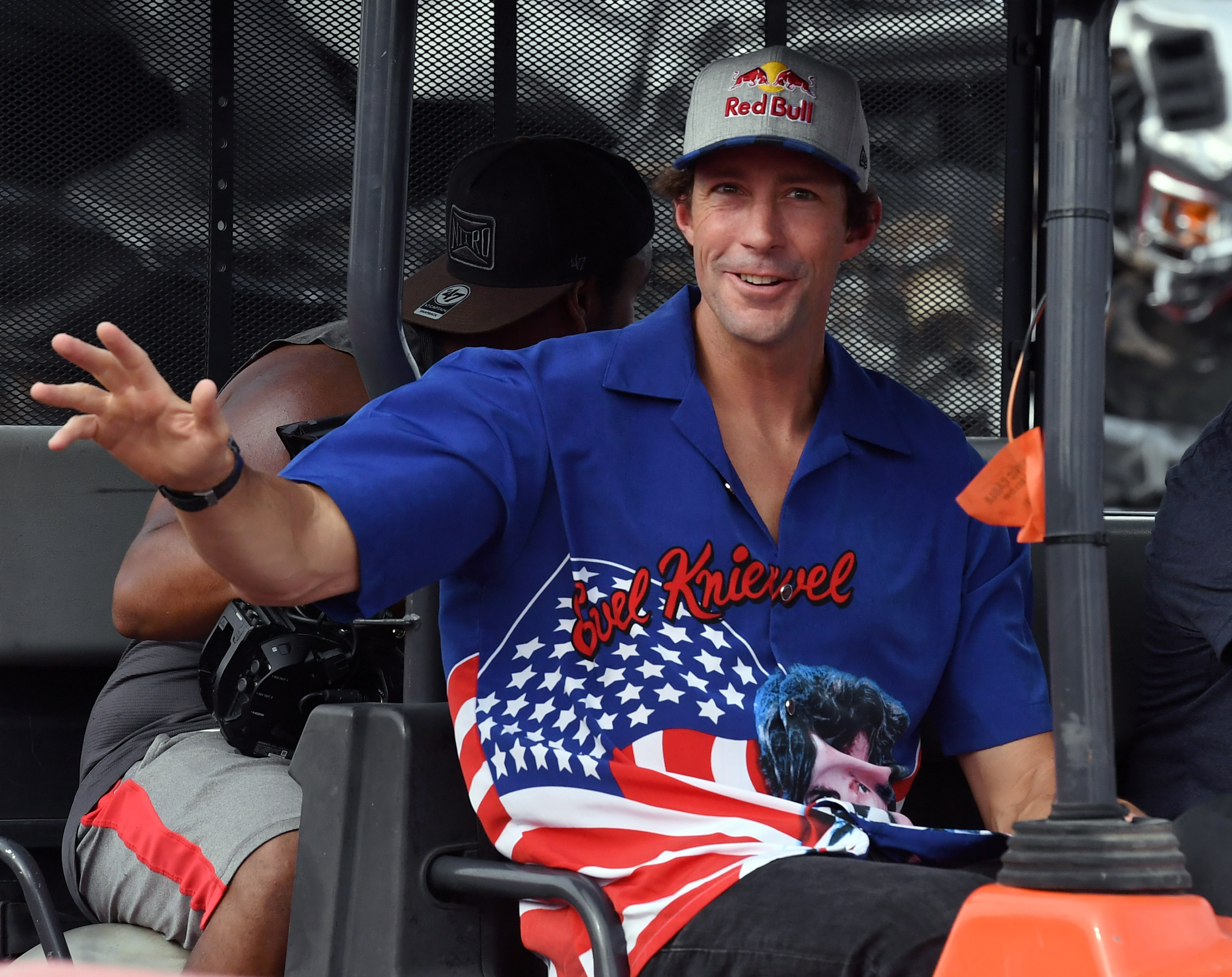 "LAS VEGAS, NV - JULY 08:  Travis Pastrana waves to fans during HISTORY's Live Event ""Evel Live"" on July 8, 2018 in Las Vegas, Nevada.  (Photo by Ethan Miller/Getty Images for HISTORY)"